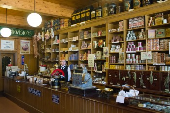 An old style store with shop keeper