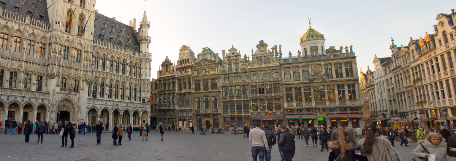 The view down Grand Place, with the town hall to the left and guild houses in front