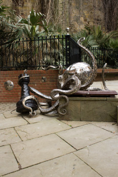 A giant shiny octopus attacks an innocent chess piece
