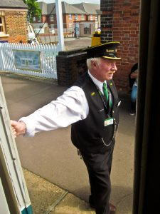 Station Master waiting to see off the train