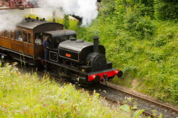 The steam train leaves the station