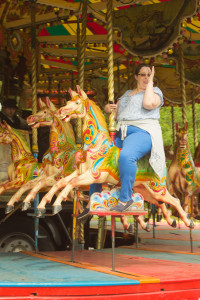 Heather makes a face on the carousel