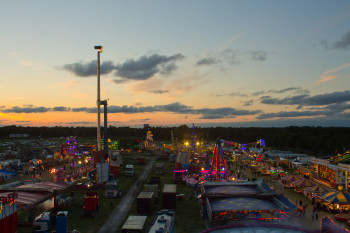 Coming down from the big wheel the fair is laid out in the fading light