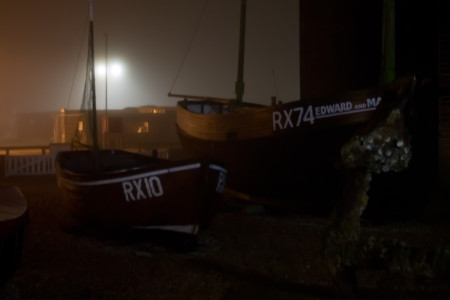 Fishing boats in the night mists